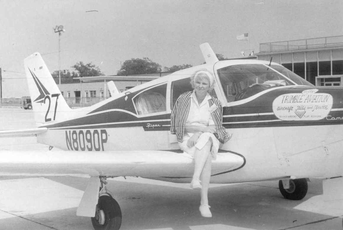 Black and white photo of Patricia M. Arnold in front of her plane. Courtesy of International Women Air and Space Museum.