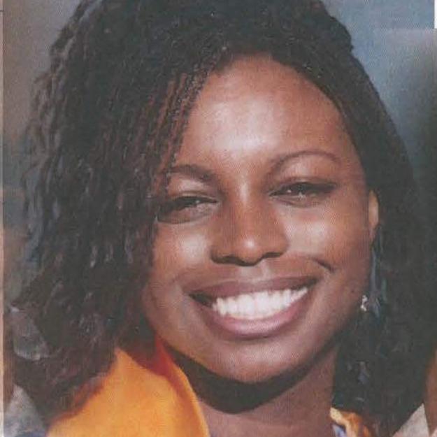 Graduation photo of Natasha McKenna, a young Black woman smiling joyfully.