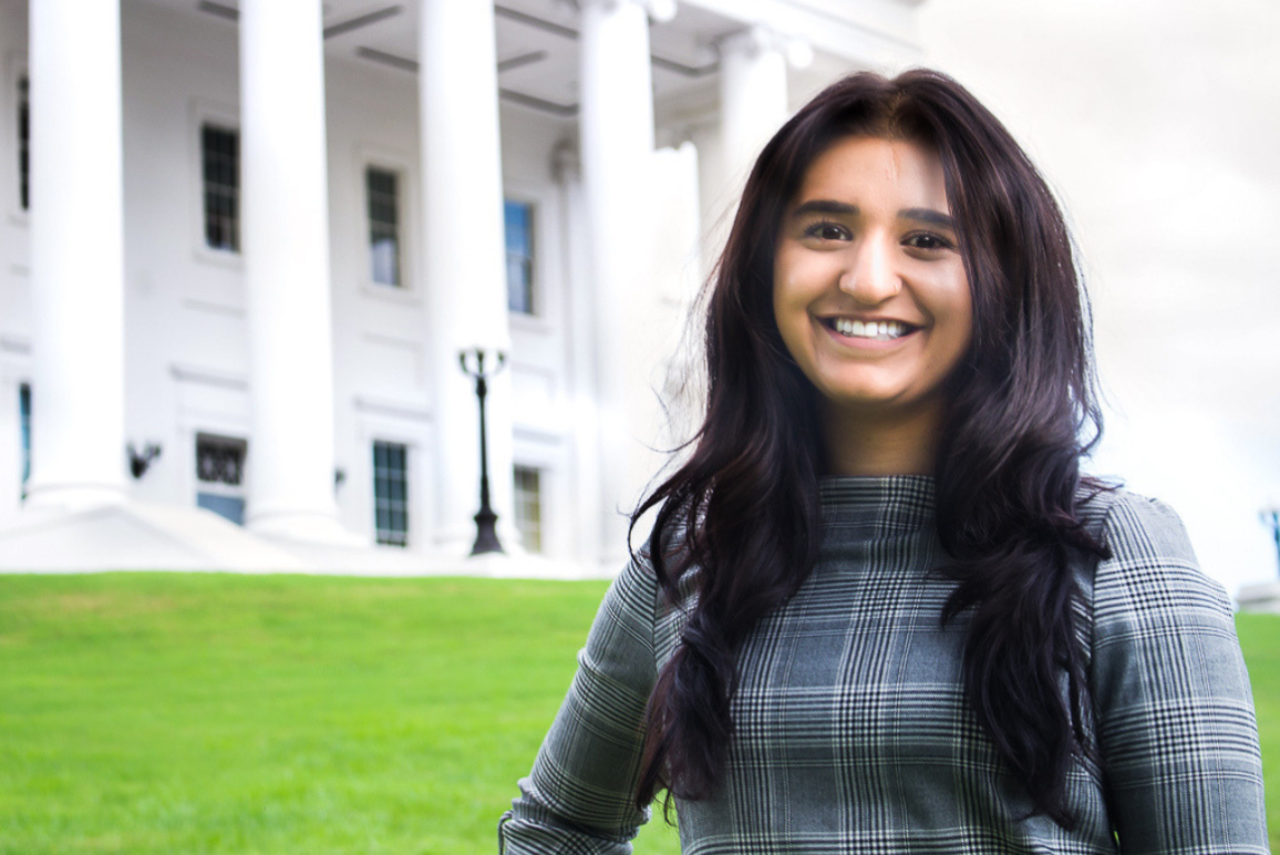A profile picture of our Legislative Director Ashna Khanna, a young woman with Indian heritage and bright smile