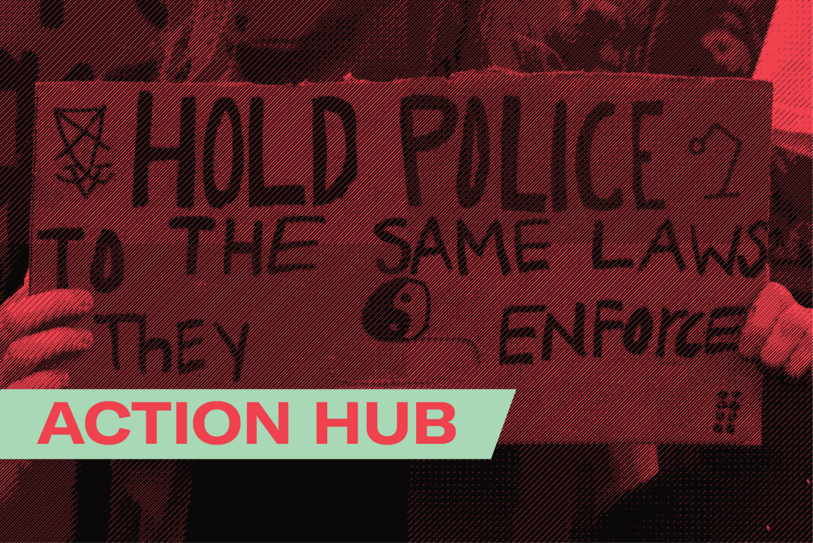 """a protester holding a sign that says """"hold police to the same laws they enforce"""""""