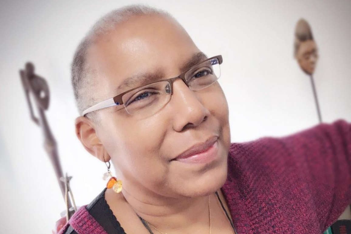 profile picture of Edith Bullard, director of communications. A Black woman with shaved head, pepper hair, with glasses and dangling earrings.