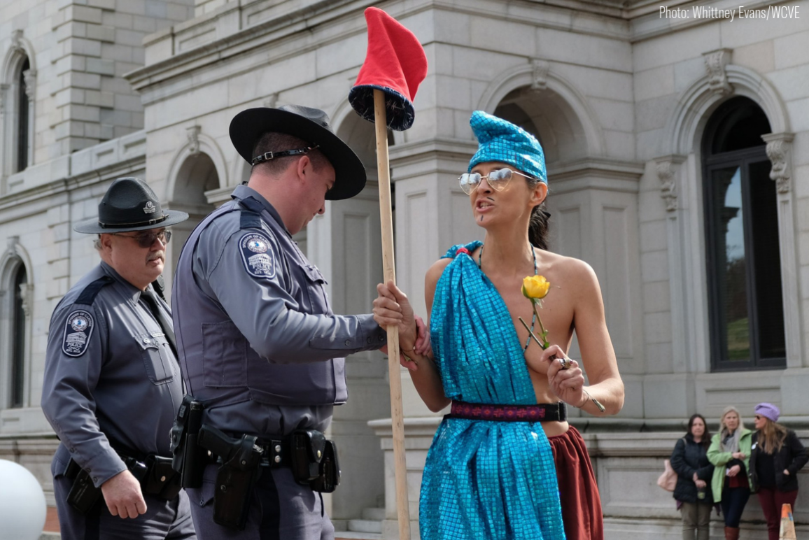 A protester dressed as Virtus to support the ERA. She was arrested for baring her left breast.