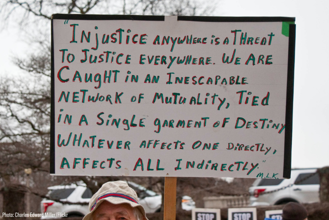 "a sign quoting Martin Luther King ""injustice anywhere is a threat to justice everywhere..."""