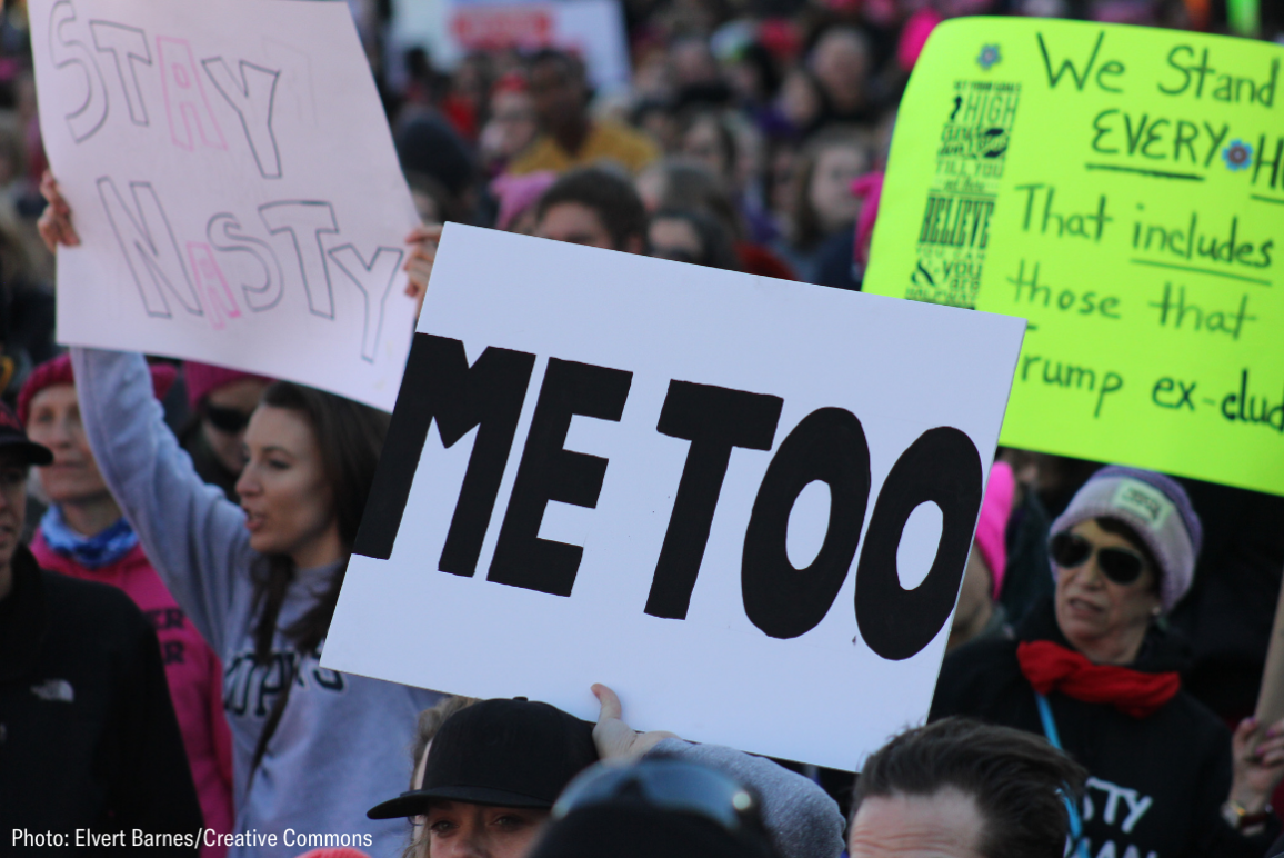 "People carrying sign that says ""Me Too"""