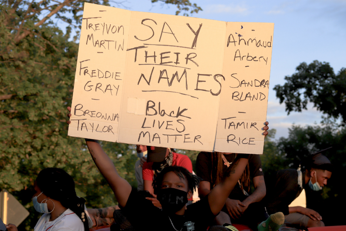 """a sign saying """"say their names"""" with the name of Breonna Taylor, Tamir Rice, and so many more"""