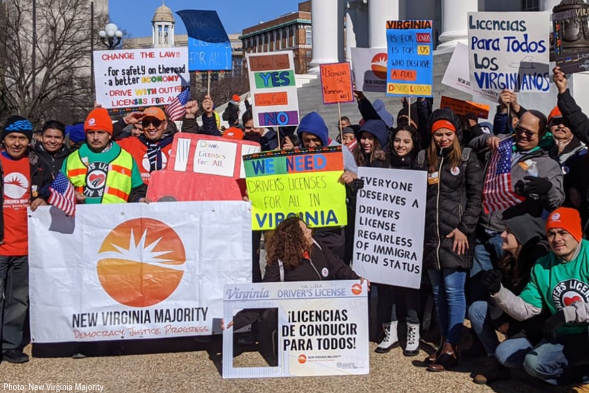 a group of advocates gathered at the Capitol with signs calling for Virginia Driver's Licenses for All