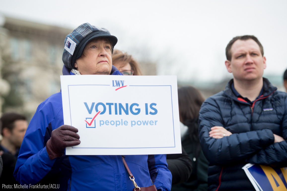 "white old woman holding a sign by League of Women Voters that said ""Voting is People Power"""