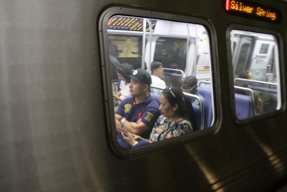 Two passengers sitting on a Metro Transit train
