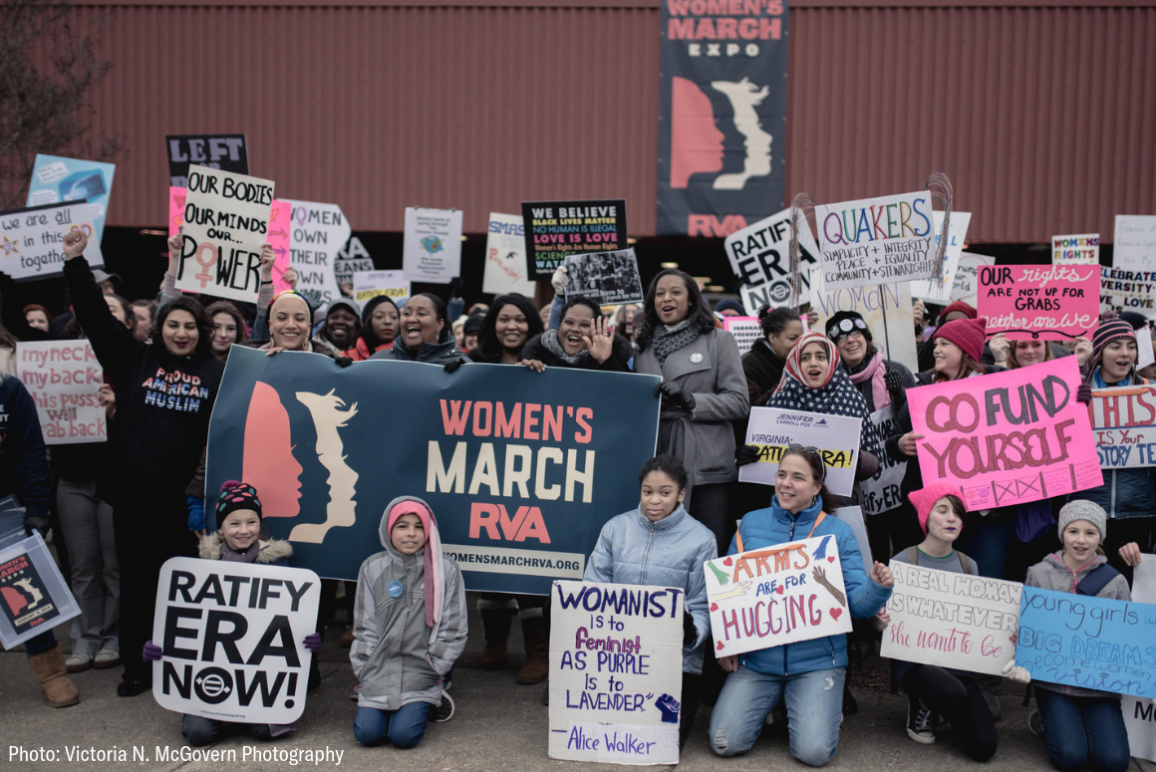 A diverse group of women posing for a picture at the Women's march 2019 in Richmond