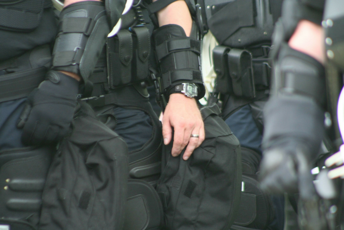 close-up picture of police in military gears